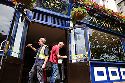 © Licensed to London News Pictures. 03/07/2020. London, UK. Painters paint the entrance to The Toll Gate, a Wetherspoon pub in north London as the pub prepares to reopen on 4 July, the 'Super Saturday'. Pubs across the UK closed on 23 March following the coronavirus lockdown. As COVID-19 lockdown restrictions are eased, pubs will reopen on Saturday 4 July. Some pubs are planning to reopen from 6am. Photo credit: Dinendra Haria/LNP