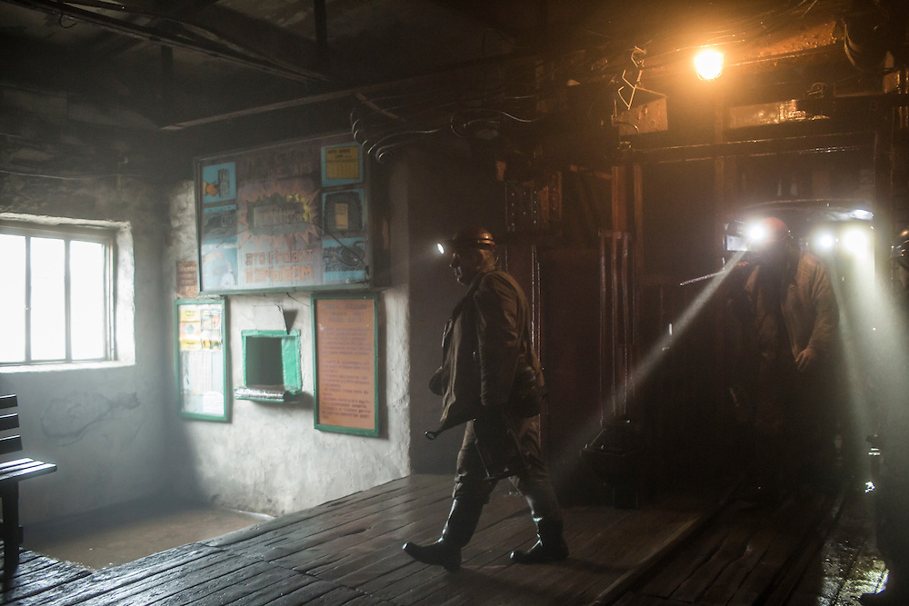 Oleksandr Grytsenko, 39, and other miners come off the elevator at the end of their shift at the Zolote Coal Mine on Tuesday, February 9, 2016 in Zolote, Ukraine. The mine is one of the oldest in the region, having first opened in 1905.