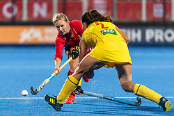 Sarah Robertson of Great Britain Women passes the ball past Bingfeng Gu of China Women during the 2019 Women's FIH Pro League match at Lee Valley Hockey Centre, Stratford<br /> Picture by Simon Parker/Focus Images Ltd <br /> 03/05/2019
