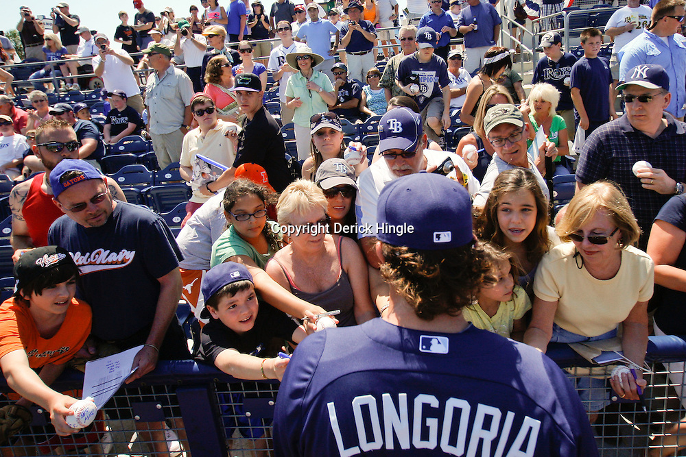 March 20, 2011; Port Charlotte, FL, USA; Tampa Bay Rays third baseman Evan Longoria (3) signs autographs for fans before a spring training exhibition game against the Baltimore Orioles at Charlotte Sports Park.   Mandatory Credit: Derick E. Hingle