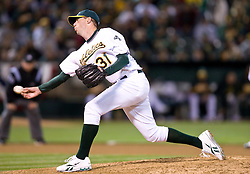 April 5, 2010; Oakland, CA, USA;  Oakland Athletics relief pitcher Brad Ziegler (31) pitches against the Seattle Mariners during the eighth inning at Oakland-Alameda County Coliseum. Seattle defeated Oakland 5-3.