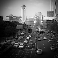 China, Shanghai. People square ; Urban highway, in the distance the radisson hotel tower