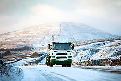 © Licensed to London News Pictures. 25/11/2017. Gearstones UK. A lorry edges it's way along the Newby Head pass in Gearstones this morning after a night of snow fall in the Yorkshire Dales. Photo credit: Andrew McCaren/LNP