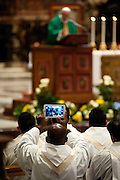Vatican City feb 9th 2016, the pope celebrates a mass for the Order of Friars Minor Capuchin. In the picture a friar takes a picture with an ipad