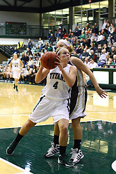 17 December 2011:  Brittany Hasselbring muscles her way to the hoop during an NCAA womens division 3 basketball game between the St. Francis Fighting Saints and the Illinois Wesleyan Titans in Shirk Center, Bloomington IL