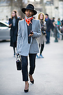 Black Hat and Orange Scarf, Outside Dries Van Noten