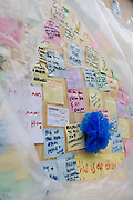 A detail of post-it notes left on the looted Poundland shop (store) in Rye Lane, Peckham after the London riots of August 2011. In response to the violence and destruction that took place the week before, communities reacted with anger in a way rarely seen in a large UK city these days. The messages vary in their sentiment but generally echo a sense of disgust at the looting and rioting with brief notes of co-operation, advice and communal encouragement. Walls like these have sprung up in other locations where destruction was widespread and locals lost their convenience stores, sports shops and even homes.