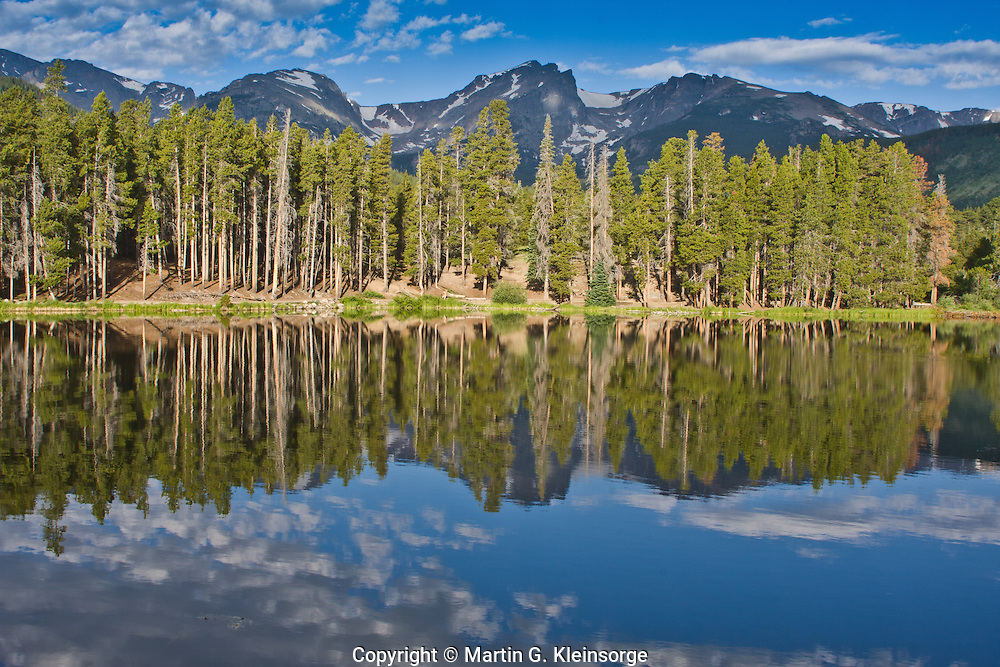 Reflections of the Front Range and the Continental Divide in Sprague Lake.  Rocky Mountain National Park, Colorado.