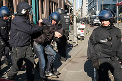 Berlin, Germany. 7th May 2016. Pro-Refugee demonstrator is arrested following scuffles with riot police in Berlin. Far-right protesters were demonstrating against islam, refugees and Angela Merkel in Mitte Berlin. Protestors demanded that Chancellor Angela Merkel stand down because of allowing large numbers of refugees and migrants to enter Germany.
