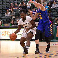 1st year guard Kyanna Giles (9) of the Regina Cougars in action during the home opener  on November  4 at Centre for Kinesiology, Health and Sport. Credit: /Arthur Images