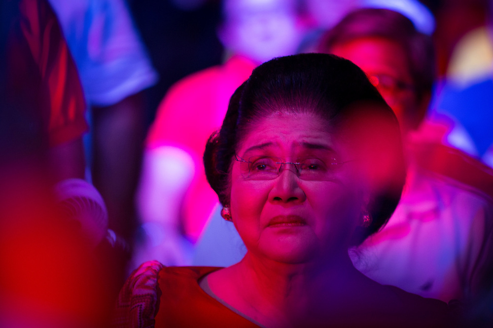 MANILA, PHILIPPINES - MAY 5: Former first lady Imelda Marcos watching Senator Ferdinand 'Bongbong' Marcos Jr. on stage for his speech in Meeting de Avance in Mandaluyong, Philippines on May 5, 2016. Senator Ferdinand 'Bongbong' Marcos Jr. is running for vice president of the Philippines. The 2016 Philippine national elections will be held on 09 May.<br />