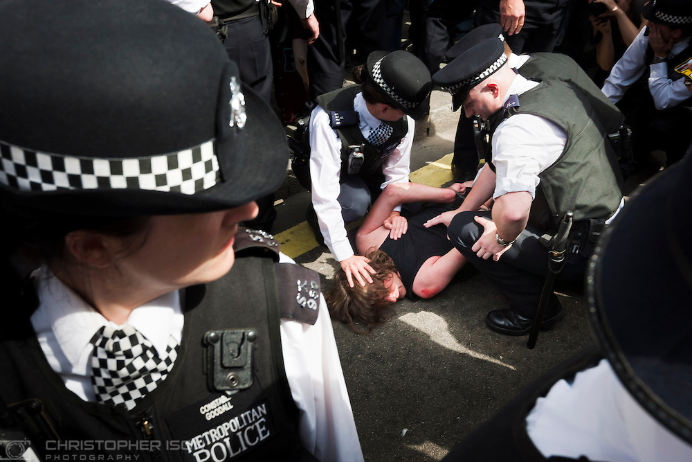 Metropolitan Police officers make arrests in Whitehall as scuffles break out following a march by public service employees through central London.