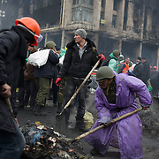 KIEV, UKRAINE - February 20, 2014: Anti-government protestors gather burned debris to fill in bags to be used in the formation of barricades, as violent clashes happen between protestors and police outside Independence Square in central Kiev. The riot police responded to the advance with gunfire that, according to the opposition, killed at least 70 and as many as 100 people. The drastic escalation of the three-month-old Ukraine crisis left the country reeling from the most lethal violence in decades. CREDIT: Paulo Nunes dos Santos