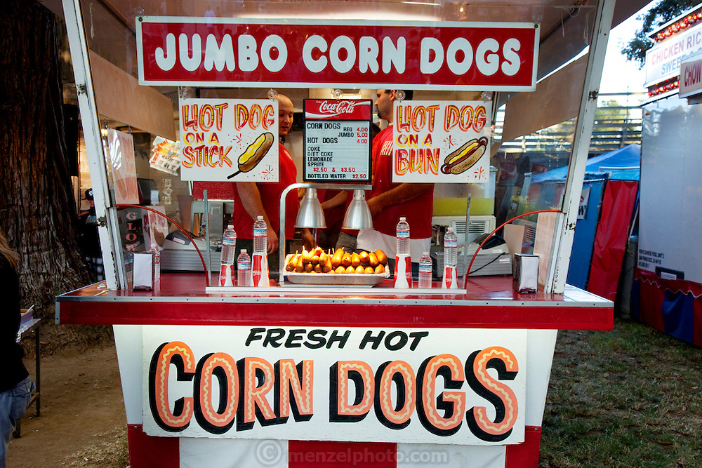 Employees man a Jumbo Corn Dog stand at the Napa Town and Country Fair in Napa, California. (From the book What I Eat: Around the World in 80 Diets.)