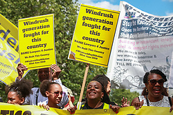 London, UK. 22 June, 2019. Campaigners from BAME Lawyers for Justice, comprised of Black Activists Rising Against Cuts (BARAC UK) and an umbrella of other race equality and Windrush justice groups, take part in a National Windrush Day of Action on Windrush Day to protest against the gross injustice, discrimination and misery suffered by people of the Windrush generation and their multi-generation families, as well as that experienced by people from other Commonwealth and former Commonwealth countries because of the Government's 'hostile environment' policies. Events in London included a rally opposite Downing Street and a march to Westminster Bridge for a mass banner drop. Similar events are taking place in at least six other cities around the UK.