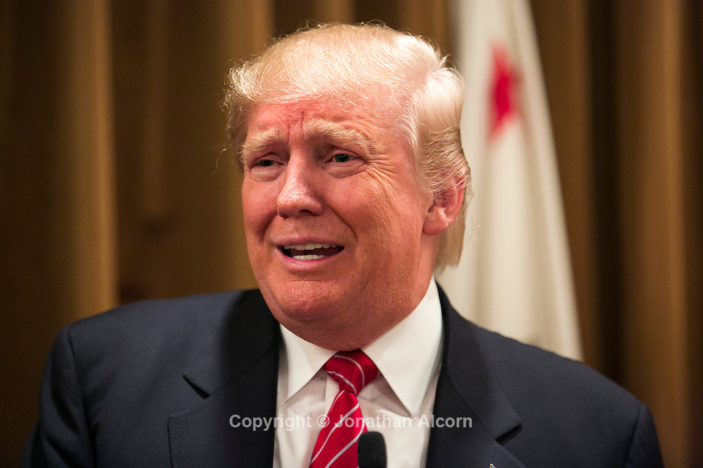 Republican presidential candidate Donald Trump speaks to the media after meeting in Beverly Hills, California with families of victims of undocumented immigrants who committed crimes, July 10, 2015.  photo Jonathan Alcorn