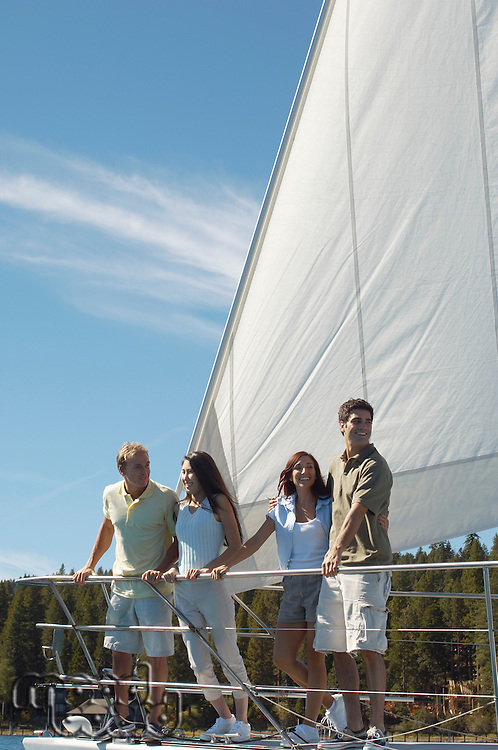 Friends Standing Together on Sailboat