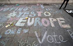 © Licensed to London News Pictures. 21/06/2016. London, UK. Activists chalk Yes to Europe slogans on the pavement at a Remain campaign event in Trafalgar Square organised via Facebook. There are only two full days of campaigning ahead of the UK EU referendum taking place on Thirsday 23rd June, 2016. Photo credit: Peter Macdiarmid/LNP