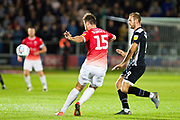 Salford City defender Cameron Burgess cross the ball during the EFL Sky Bet League 2 match between Salford City and Grimsby Town FC at Moor Lane, Salford, United Kingdom on 17 September 2019.