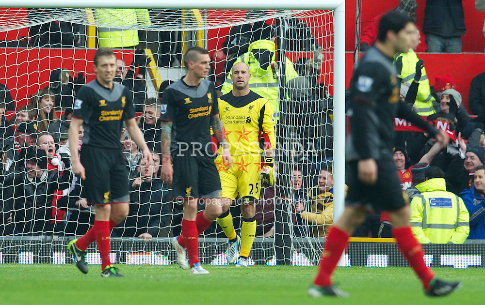 MANCHESTER, ENGLAND - Sunday, January 13, 2013: Liverpool's goalkeeper Jose Reina looks dejected as Manchester United score the opening goal during the Premiership match at Old Trafford. (Pic by David Rawcliffe/Propaganda)