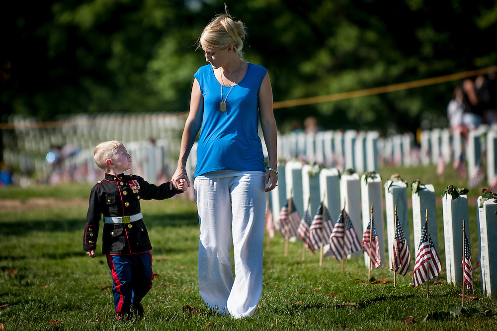 On Memorial Day, Brittany Jacobs of Hertford, North Carolina walks along the rows of headstones in Section 60 at Arlington National Cemetery with her son, Christian, 3, in Arlington, Virginia, USA, on 26 May 2014. Jacobs and her son were visiting the grave of her husband, Marine Sgt. Christopher Jacobs.