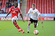 Walsall midfielder Romaine Sawyers on the attack watched by Crewe Alexandra midfielder Ryan Colclough during the Sky Bet League 1 match between Walsall and Crewe Alexandra at the Banks's Stadium, Walsall, England on 26 September 2015. Photo by Alan Franklin.