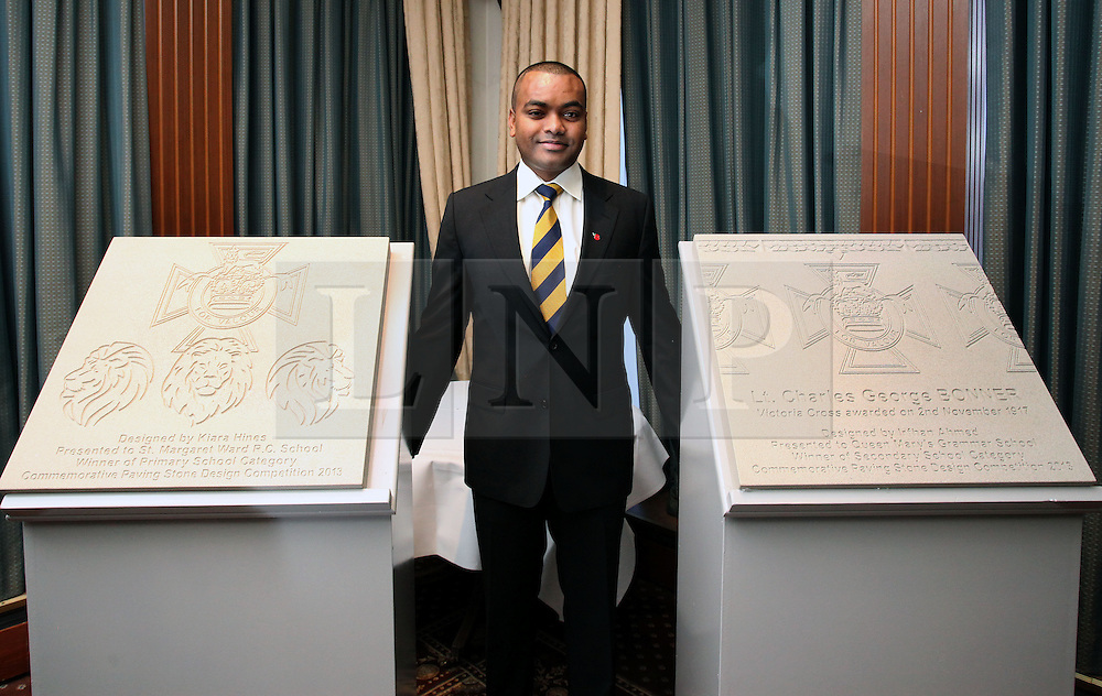 © Licenced to London News Pictures. 04/11/2013. London. UK.  <br /> Lance Sergeant Johnson Beharry, the first living recipient of the Victoria Cross in over 30 years, is pictured with the school winners of the paving stones which will commemorate recipients of the Victoria Cross during the First World War at the Army and Navy Club in London, November 4th 2013. The overall winning design, following a national competition, will be set in stone in over 400 communities across the United Kingdom to commemorate those First World War soldiers who were awarded the Victoria Cross for valour 'in the face of the enemy'.<br /> Photo Credit: Susannah Ireland
