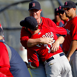 February 23, 2011; Fort Myers, FL, USA; Boston Red Sox starting pitcher Jon Lester (31) and second baseman Dustin Pedroia (15) during spring training at the Player Development Complex.  Mandatory Credit: Derick E. Hingle
