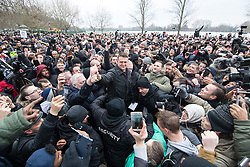 "© Licensed to London News Pictures . 18/03/2018 . London , UK . TOMMY ROBINSON (centre) arrives . Alt-right groups , including Generation Identity , and antifascist opponents , demonstrate at Speakers' Corner in Hyde Park where Tommy Robinson reads a speech by Generation Identity campaigner Martin Sellner . Along with Brittany Pettibone , Sellner was due to deliver the speech last week but the pair were arrested and detained by police when they arrived in the UK , forcing them to cancel an appearance at a UKIP "" Young Independence "" youth event , which in turn was reportedly cancelled amid security concerns . Photo credit: Joel Goodman/LNP"