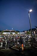 In The Pre-Dawn Conditions Age Group Competitors prepair their Equipment in Transition Before The Swim Start. 2012 Ironman Cairns Triathlon. Cairns, Queensland, Australia. 03/06/2012. Photo By Lucas Wroe.