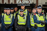 Riot police guard a Casino on the route - A student march against fees and many other issues starts in Malet Street and heads for Westminster via the West End.