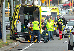 March 15, 2019 - Christchurch, Canterbury, New Zealand - An injured person is loaded in an ambulance following a shooting resulting in multiple fatalities and injuries at the Masjid Al Noor Mosque, Deans Avenue, Christchurch, New Zealand. At least 49 people were killed and 20 seriously injured in mass shootings at two mosques in the New Zealand city of Christchurch. 48 people, including young children with gunshot wounds, were taken to hospital. Three people were arrested in connection with the shootings. (Credit Image: © Martin Hunter/SNPA via ZUMA Wire)