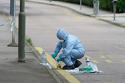 ©Licensed to London News Pictures25/07/2020     <br /> Chislehurst, UK. A forensic officer removing for evidence what looks like a sharpened chisel from the road next to the kerbside. A male pedestrian has been involved in a collision with a van in Chislehurst, South East London, The van did not stop. The London air ambulance was called but the man sadly died at the scene a police cordon is in place and at this time it is believed the police are linking this incident to the double stabbing at the Gordon Arms pub in Chislehurst. Photo credit: Grant Falvey/LNP