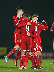 BALLYMENA, NORTHERN IRELAND - Thursday, November 20, 2014: Wales' Liam Cullen, captain Tyler Roberts and Keiran Evans celebrate after beating Northern Ireland 2-0 and winning the Victory Shield during the Under-16's Victory Shield International match at the Ballymena Showgrounds. (Pic by David Rawcliffe/Propaganda)