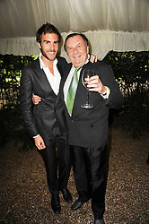OSCAR HUMPHRIES and his father BARRY HUMPHRIES at the Apollo Magazine Summer Party held at 22 Old Queen Street, London, SW1 on 29th June 2010.