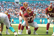 Sunday, October 13, 2019; Miami Gardens, FL USA;  Washington Redskins quarterback Case Keenum (8) prepares to receive the snap from center Chase Roullier (73) during an NFL game at Hard Rock Stadium. The Redskins beat the Dolphins 17-16. (Kim Hukari/Image of Sport)