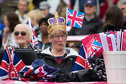 Trafalgar Square, London, June 12th 2016. Rain greets Londoners and visitors to the capital's Trafalgar Square as the Mayor hosts a Patron's Lunch in celebration of The Queen's 90th birthday. PICTURED: A woman watches the entertainers on stage.