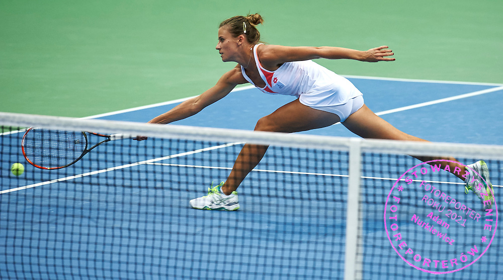 Alicja Rosolska from Poland while doubles game during the Fed Cup / World Group Play Off tennis match between Poland and Switzerland on April 19, 2015 in Zielona Gora, Poland<br /> Poland, Zielona Gora, April 19, 2015<br /> <br /> Picture also available in RAW (NEF) or TIFF format on special request.<br /> <br /> For editorial use only. Any commercial or promotional use requires permission.<br /> <br /> Adam Nurkiewicz declares that he has no rights to the image of people at the photographs of his authorship.<br /> <br /> Mandatory credit:<br /> Photo by &copy; Adam Nurkiewicz / Mediasport