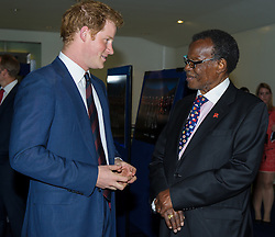 Image ©Licensed to i-Images Picture Agency. 10/06/2014. London, United Kingdom. HRH Prince Harry attends the 50th Anniversary of Zulu premiere. . Picture by Anthony Upton / i-Images<br /> Leicester Square, London, 10 June 2014: HRH Pr. Harry with Pr. Buthelezi, who starred in the original film at a gala screening to celebrate the 50th Anniversary of Zulu where guests were joined by Prince Harry to watch a digitally remastered version of the iconic film. The evening was arranged to raise money for two charities supported by Prince Harry, Walking With The Wounded and Sentebale. <br /> For further info please contact<br /> Emily Conrad-Pickle Captive Minds<br /> Mobile: +44 (0)7799 414 790<br /> emily.conrad-pickles@captiveminds.com