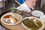 A variety of tomales (left wrapped and steamed in  in corn husk, right wrapped/steamed in banana leaf) at Flor de Lis