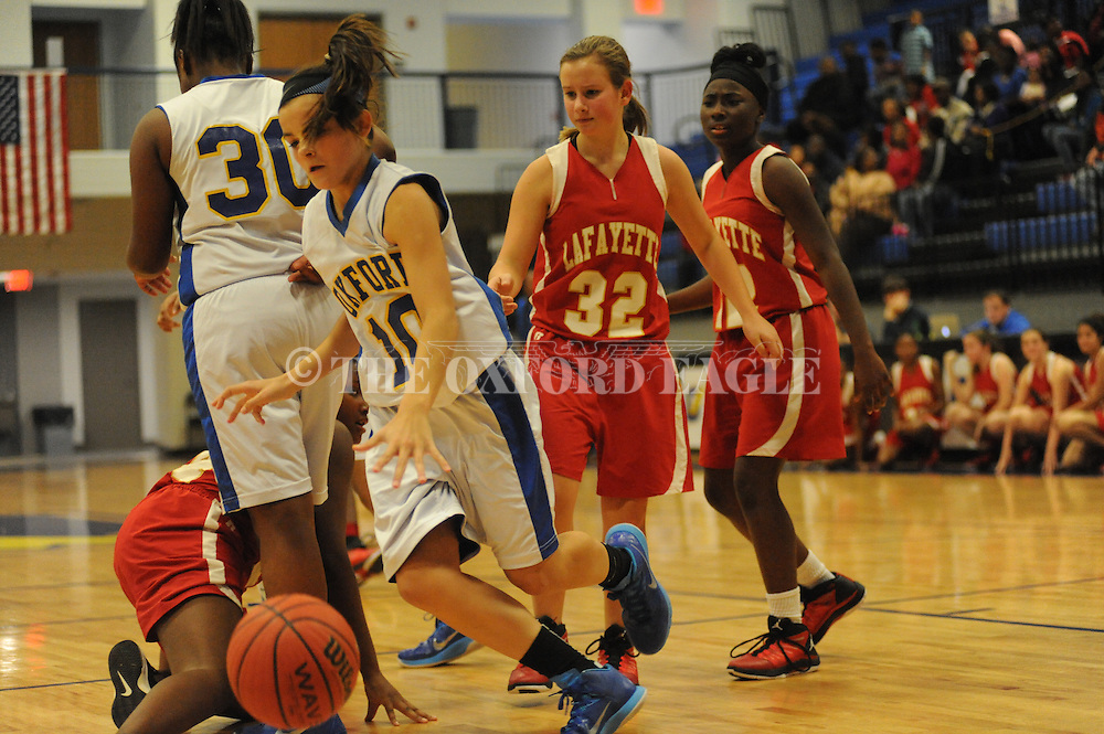 Oxford Middle School's Morgan O'Connor (10) vs. Lafayette Middle School in girls 7th grade basketball action in Oxford, Miss. on Thursday, December 11, 2014.