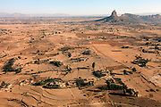 """Occupying a high plateau and bordering with Eritrea in the very north of Ethiopia lies the ancient Province of Tigray. It is an area widely considered to be the fulcrum of Ethiopian culture with towns dated to before the birth of Christ. Distinctively different from the rest of Ethiopia, strongly Orthodox Christian and culturally proud, Tigray is a mountainous and rocky region dotted with ancient churches carved in to sandstone cliffs. Filling these churches are old religious manuscripts and Bibles safe-guarded by protective Priests. Its remoteness has protected the culture as well as the religious sanctuaries that have been described as """"the greatest of the historical-cultural heritages of the Ethiopian people"""". But now Tigray is at a crossroads. Improved infrastructure has led to an opening up of even the remotest towns and villages. Signs of modernity such as internet cafes and cell phones are increasingly being used by younger Tigraians dressed in jeans and T-shirts. Yet the Church remains an ancient and powerful institution which protects its ancient customs creating scenes that haven't changed since Biblical times.."""