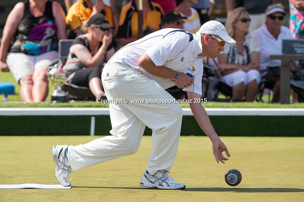 Onehunga`s Richard Girvan bowls in the men`s pairs final at the National Open Bowls Championship 2014, Browns Bay Auckland, New Zealand, Sunday, January 04, 2015. Photo: David Rowland/www.photosport.co.nz