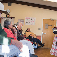 121914       Cable Hoover<br /> <br /> Miss Teen Navajo Violetta Dempsey sings traditional songs to residents of McKinley Manor in Gallup Friday.