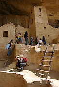 Tourists explore the Cliff Palace ruins during a guided tour at Mesa Verde National Park in Colorado. Colin Braley/Wild West Stock