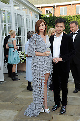 ANASTASIA VIRGANSKAYA and DIMITRI ZANGIEV at the Raisa Gorbachev Foundation Party held at Stud House, Hampton Court Palace on 5th June 2010.  The night is in aid of the Raisa Gorbachev Foundation, an international fund fighting child cancer.