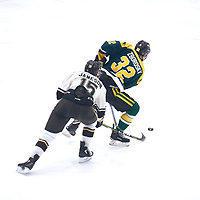 2nd year forward, Zak Zborosky (32) of the Regina Cougars during the Men's Hockey Home Game on Sat Jan 19 at Co-operators Center. Credit: Arthur Ward/Arthur Images