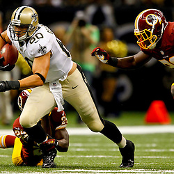 September 9, 2012; New Orleans, LA, USA; New Orleans Saints tight end Jimmy Graham (80) breaks away from Washington Redskins safety DeJon Gomes (24) and linebacker Brian Orakpo (98) during the first half of a game at the Mercedes-Benz Superdome. Mandatory Credit: Derick E. Hingle-US PRESSWIRE