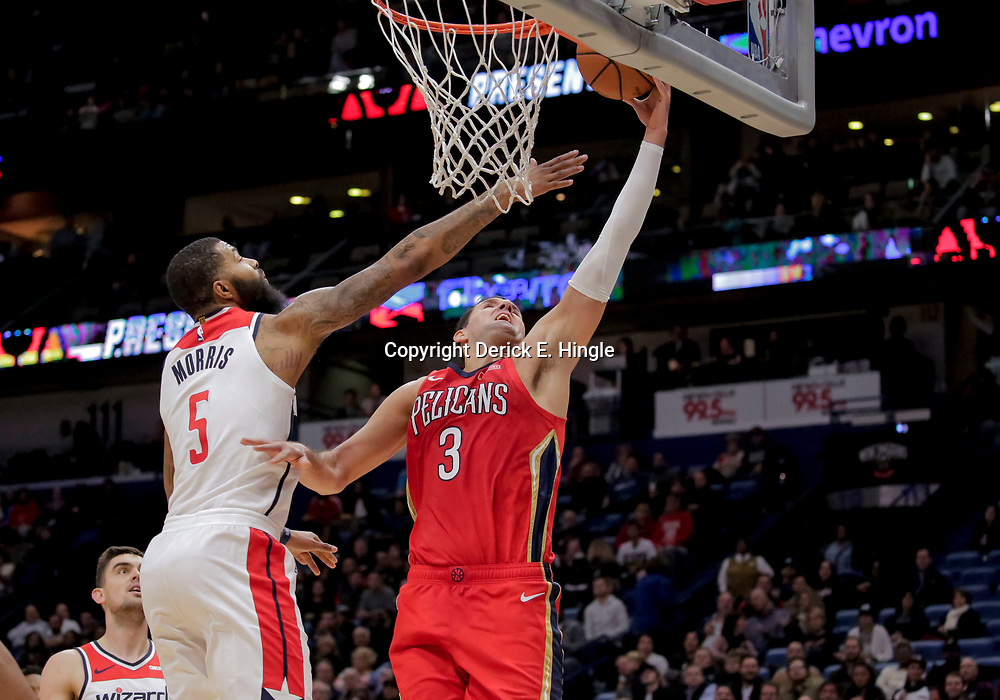 Nov 28, 2018; New Orleans, LA, USA; New Orleans Pelicans forward Nikola Mirotic (3) shoots over Washington Wizards forward Markieff Morris (5) during the fourth quarter at the Smoothie King Center. Mandatory Credit: Derick E. Hingle-USA TODAY Sports
