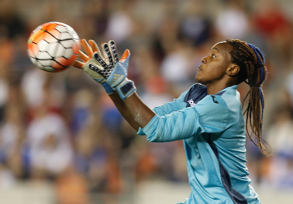 Feb 19, 2016; Houston, TX, USA; Trinidad & Tobago Goalkeeper Kimika Forbes (1) makes a save against USA  the first half during the semifinals of the 2016 CONCACAF women's Olympic soccer tournament at BBVA Compass Stadium.  Mandatory Credit: Thomas B. Shea-USA TODAY Sports